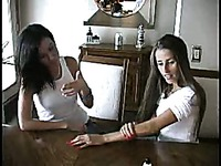 Lori Anderson and her girlfriend inspect their long arm hair at the table