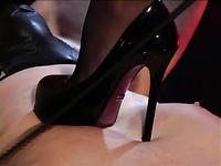 Leggy high heel domina Stella Van Gent in black outfit dominates a man in nylon mask