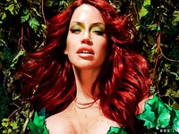 Beautiful red-haired model Bianca Beauchamp poses in green latex costume