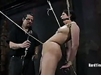 Bare foot bound slave Marina gets her breasts and snatch punished in the dark