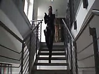 Sexy secret agent Stella Van Gent dressed in black walks down the stairs
