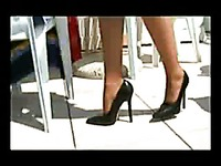 High heel lady Stella Van Gent in sexy mini skirt gives a hot view of her beautiful legs