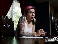 Gothic chick Joanna Angel with pink hair and tattooed arms writes a letter