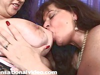 Plump lesbian women Jammin Jennie and Curvaceous Candy lick each other and play with strapon