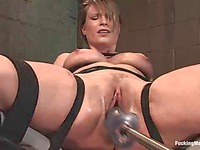 Helpless tied up brunette Harmony Rose gets her snatch dildo fucked before riding the sybian