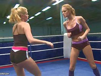 Katalin Kiraly and Lily Love fight wit desire trying to remove each others uniform