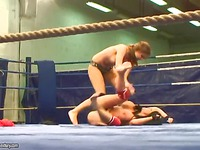 Big racked brunette fighter Kerry Louise and her opponent strip naked in front of referee