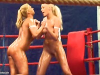 Oiled up blondes Teena and Linda Ray fight in their bare skin in the ring