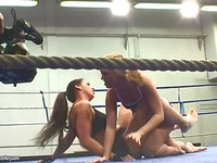 Blonde Linda Ray and brunette Losas Sparkle get the fight started with their tight uniform on