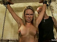 Busty slaved girl Rain DeGrey with shaved pussy gets clothespinned in the dungeon