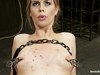 Alluring blonde haired girl Tara Lynn gets tormented in metal restraints
