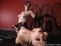 Anastasia Pierce fucks the shit out of her big titted lesbian slave Jewell Marceau