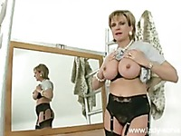 Round assed mature lady Lady Sonia in black nylons poses in front of the mirror