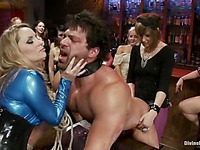 Maitresse Madeline and Aiden Starr punish tied up slave man Vince Ferelli at femdom party
