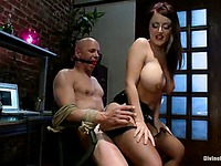 Slave Chad Rock gets his ass fucked doggy style by busty Sophie Dee after spanking and CBT