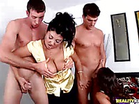 Latina brunette Jaylene Rio and another big titted milf brunette suck cock like crazy