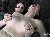 Tied up Emily Marilyn gets her big jugs and smooth snatch use by glassed domina
