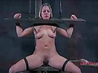 Sexy bodied slave girl Dia Zerva gets her feet whipped and her nipples clamped