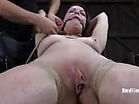 Rope bound Lilla Katt gets her ass and bare hairless pussy caned in the middle of the dungeon