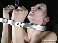 Helpless girl Elise Graves demonstrates every inch of her nude skinny body in the dungeon