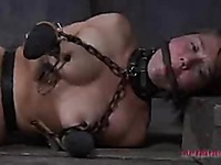 Star plays a part of slave girl that gets her ass ruthlessly dildo fucked in the dungeon