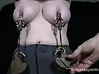 Handcuffed Sybil Hawthorne in pantyhose gets punished in the dark of the room