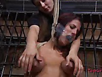 Clothed mistress Sister Dee loves touching bare big boobs of naked helpless Lavender Rayne