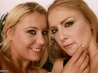 Lez blondes Gilda Roberts and Selena pose together and give playful smiles before fisting