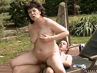 Lucky older woman Helena May bounces on stiff young dick at the poolside