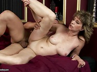Stacked mature lady Judyt gets her shaved pussy slammed in spoon position
