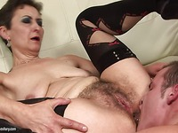 Hairy granny Marica in black stockings gets her asshole licked by bad boy