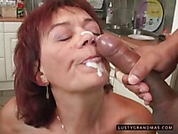 Granny Marsha licks sperm off her fingers and lips after interracial fucking in the kitchen