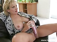 Big titted mature blonde Lady Sonia spends time watching porn and masturbating