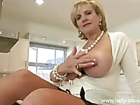 Mature Lady Sonia shows off her beautiful big boobs and pussy in the kitchen
