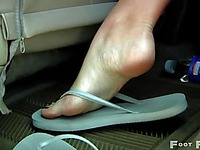 Beautiful brunette Adrienne Manning shows off her sexy legs and feet in the backseat of a car