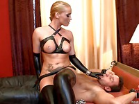 Dressed in leather, hot and sexy, Kathia Nobili makes a man obey her sexual desires!