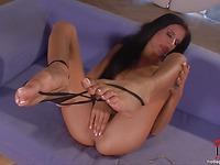 Gorgeous leggy brunette model Klara Smetanova kicks off her high heels and rubs her bare pussy