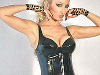 Fascinating blonde Saffron Taylor poses in latex before showing her perfect huge tits