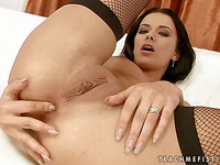 Slim euro babe Shalina Devine in stockings exposes her clean tight pussy and fingers her asshole