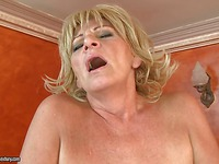 Slutty blonde granny Sally G. takes hard young dick as deep as possible in her bushy pussy