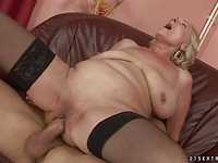 Shaved pussy granny Sila in black stockings sucks and rides stuff dick like crazy
