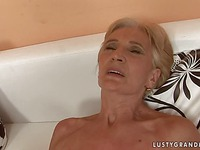 Older blonde Viviana with hairy mature pussy gets shagged on the edge of the couch