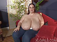Fat brunette in jeans Monique goes topless to show her unbelievably big natural breasts