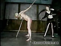 Busty slave blonde Adrianna Nicole with apple ass and shaved pussy gets spanked hard by domina