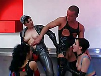 Marcy Sin shares a cock in hot fetish orgy with other women dressed in latex