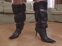 Blonde Vicky takes off her high heel boots and dildos her pussy barefoot
