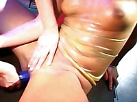 Peggy Sue and other latex-clad lezzies stick dildos in their wet pussies