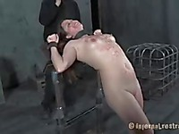 Fully nude bound brunette Alexxa Bound gets her pussy spread and filled with toy in the dungeon