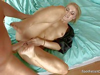 Hot blonde Ash Hollywood gives a footjob and gets a hardcore pounding from a foot & legs fetish guy
