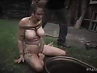 During bondage sex action with Rain DeGrey, she is showing off her body with pleasure.